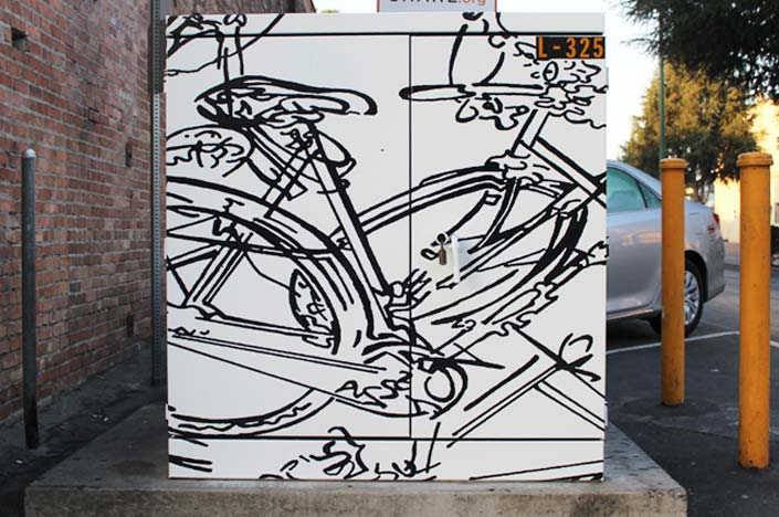 A power box with a bicycle painted on it.